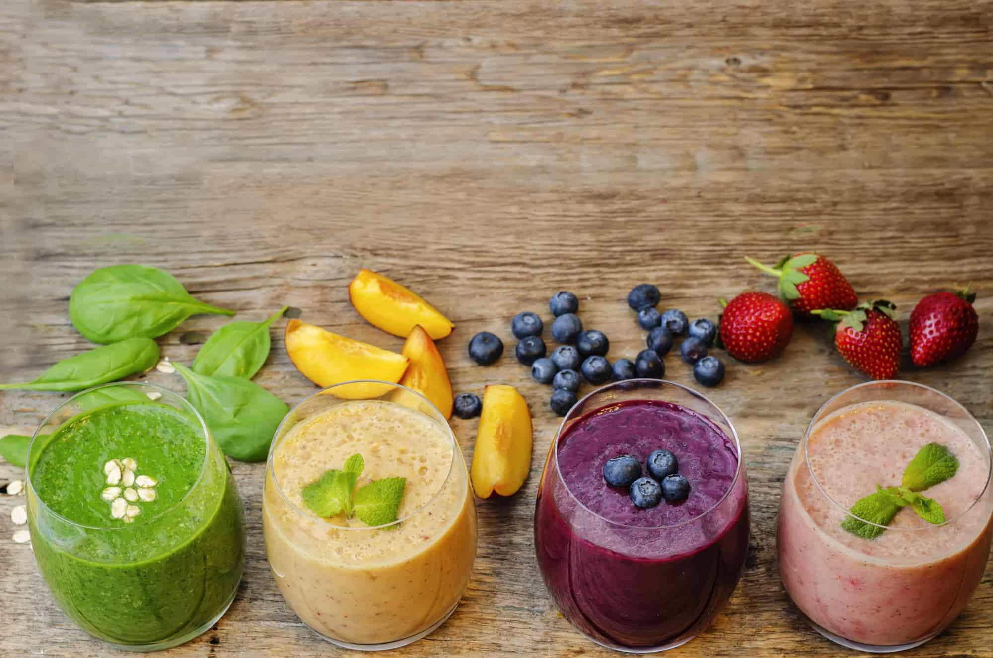 smoothie with blueberries, peach, spinach and strawberries